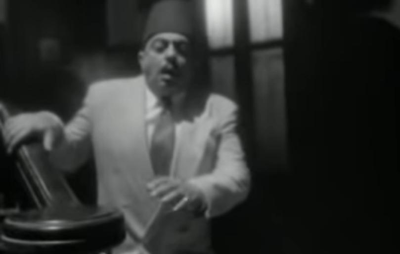 مشهد اغتيال أمين عثمان في فيلم أيام السادات